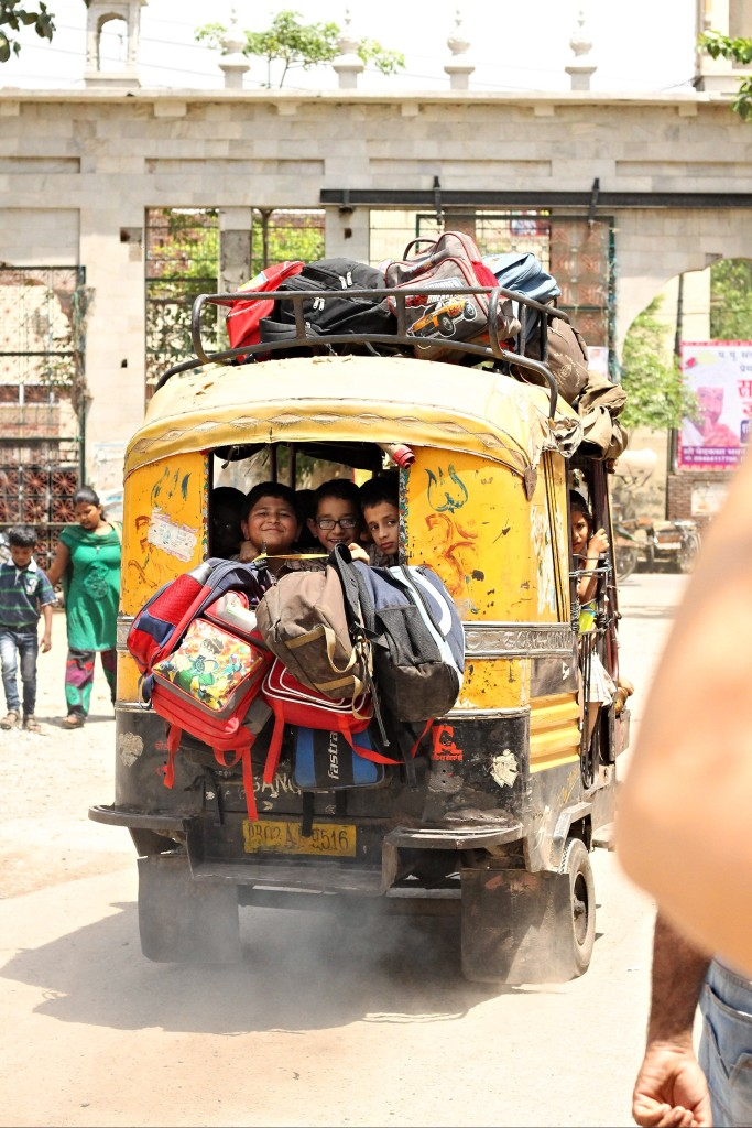 At least 12 happy faces headed home from school in this autorickshaw © Nisha D'Souza