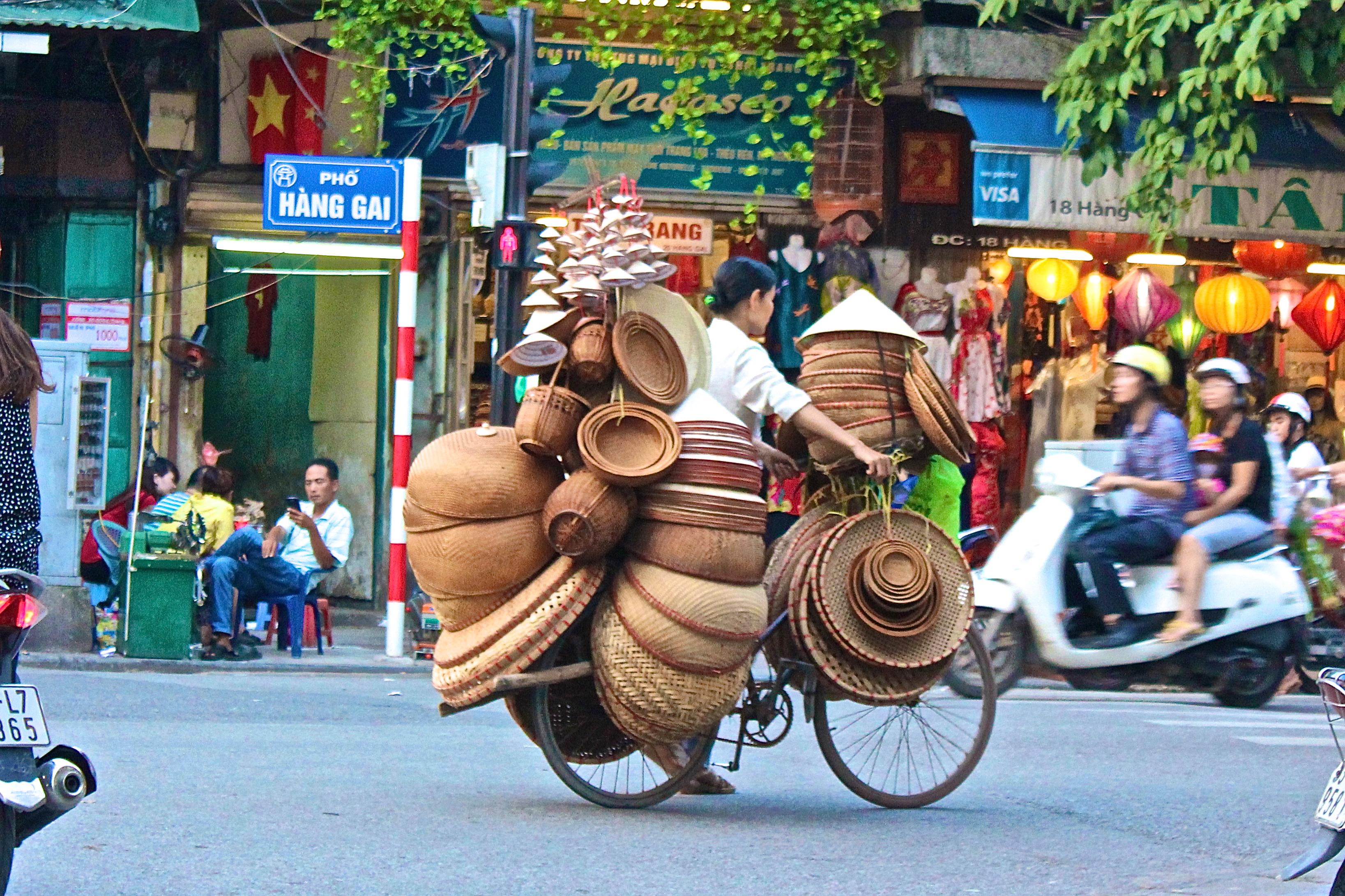The innate Vietnamese ability to over-stack all two-wheeler with the oddest of items ranging from hats to pigs, is flabbergasting (Hanoi)© Nisha D'Souza