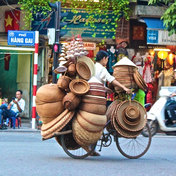 Vietnamese have an innate ability to over-stack all two-wheeler with the oddest of items, Hanoi, Vietnam
