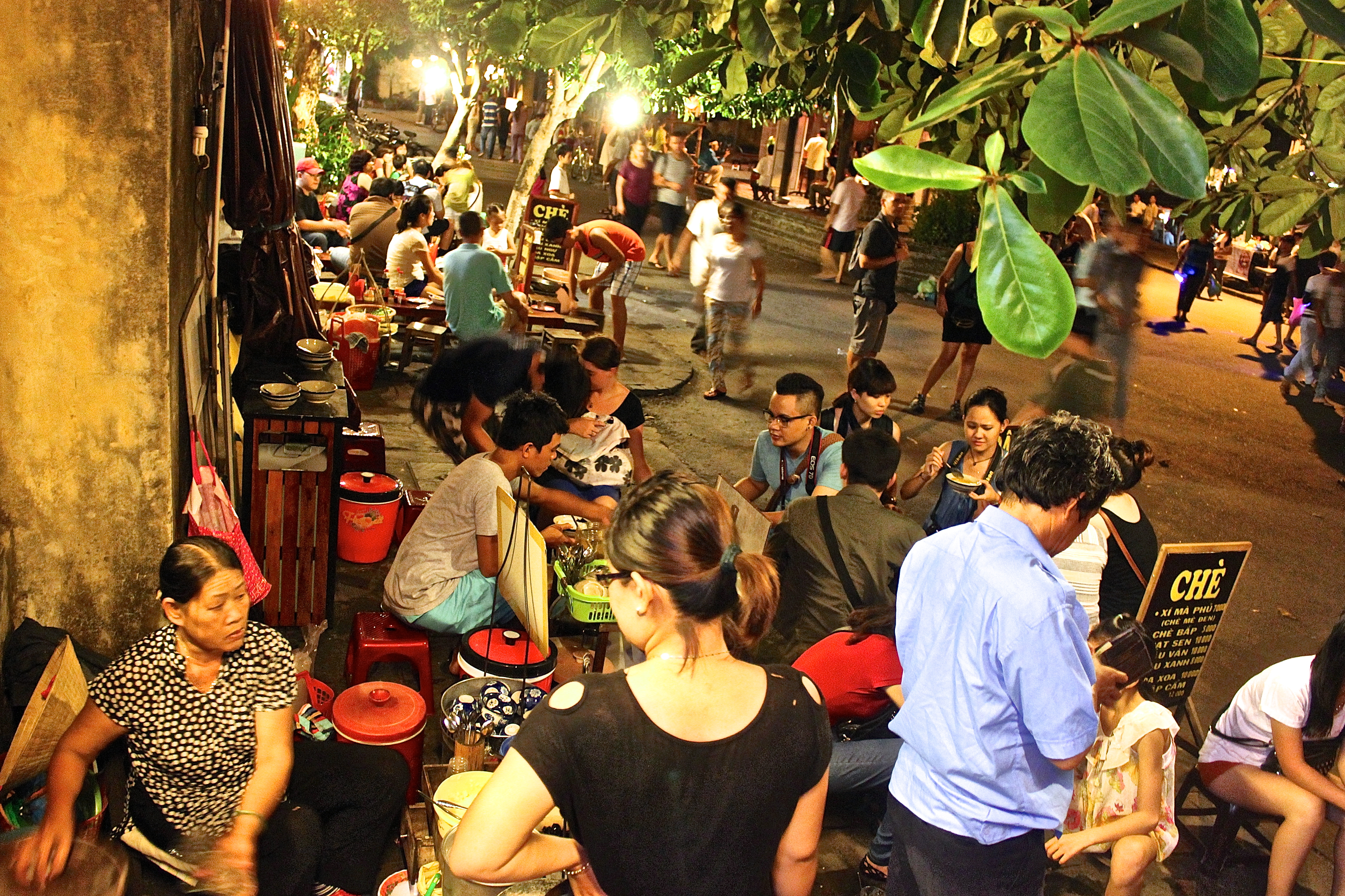 The bustling street-side food vendors of Hoi An are never short of business; Vietnamese coffee can empower one with Flash-like abilities and Pho will give you the courage of an ox (if it's beef) or the gentleness of a women (if it's chicken). © Nisha D'Souza