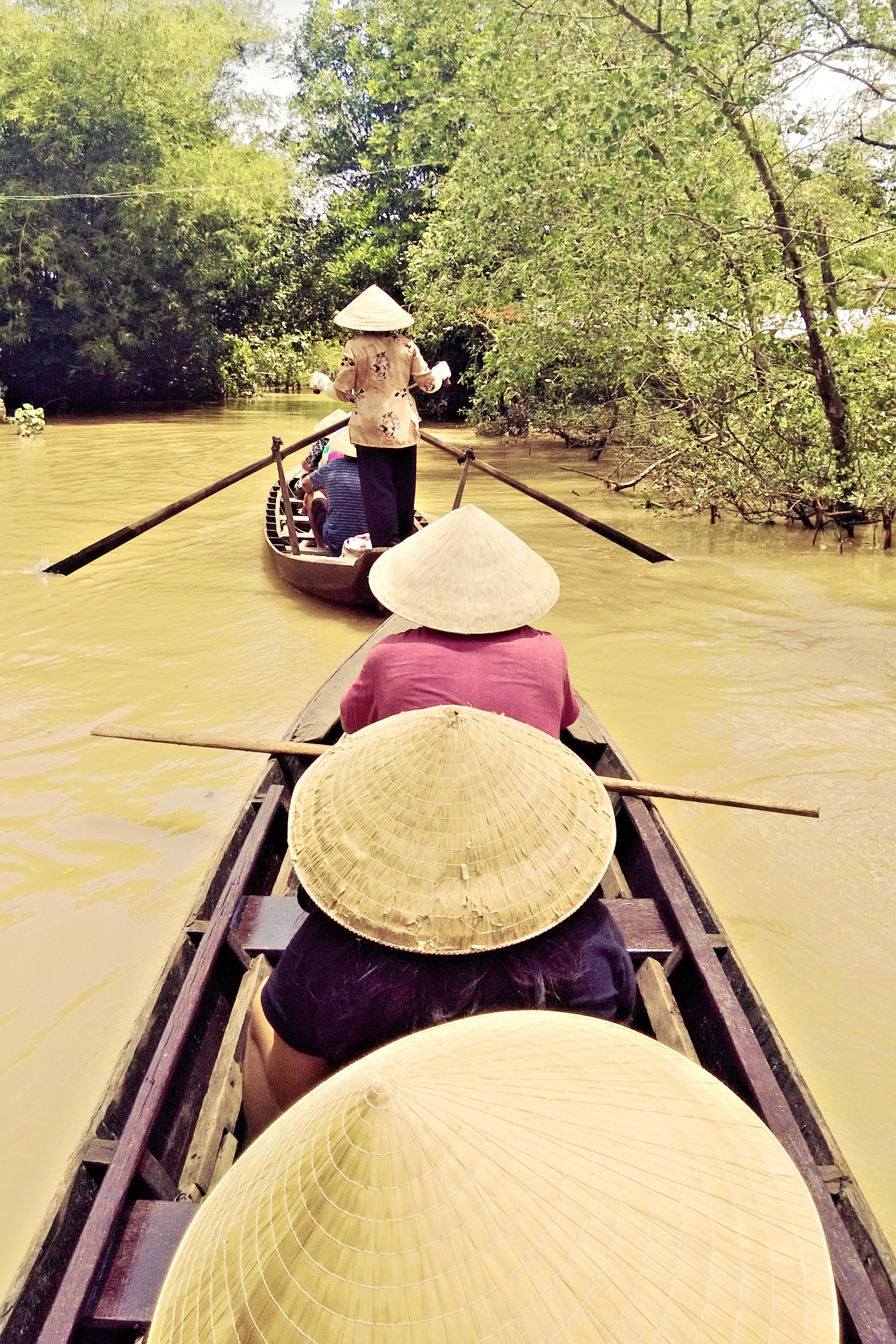 Adventures under the shade of a conical hat, Mekong river, Vietnam © Nisha D'Souza