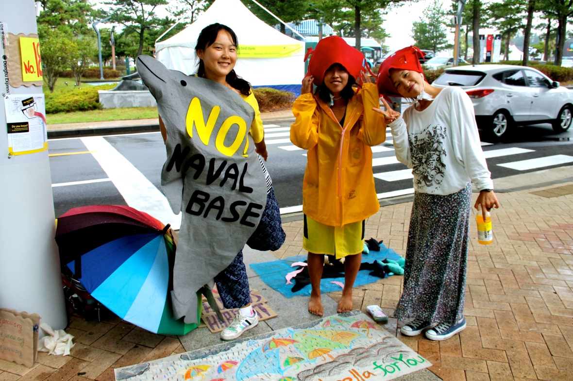 Young girls play their part in protesting the construction of the naval base © Nisha D'Souza