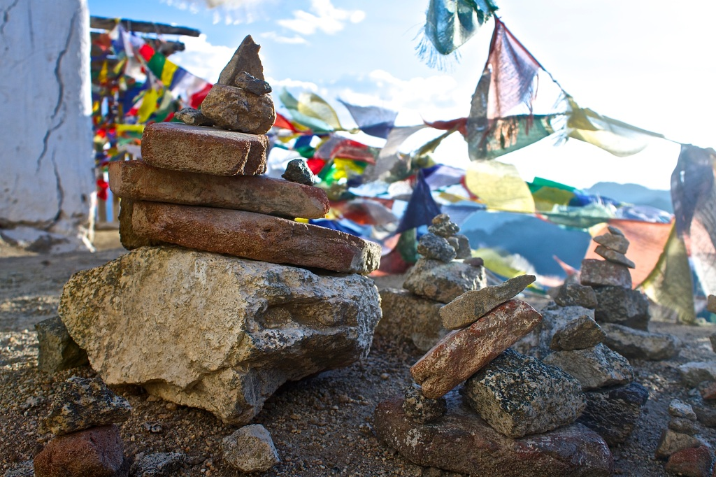 Stone piles symbolizing good luck and wishes made are found all over Ladakh© Nisha D'Souza