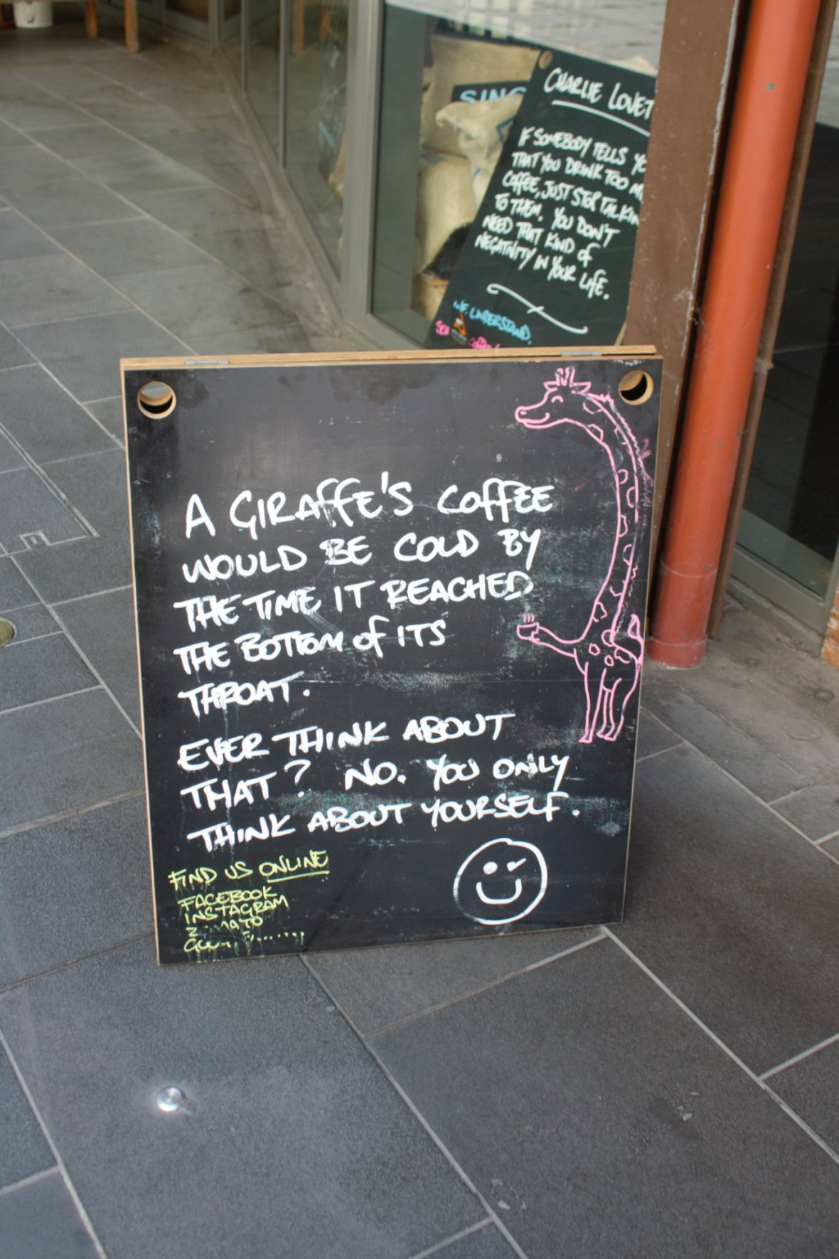 Think of someone else for a change! Humourous cafe signs add to the fun of exploring Melbourne © Nisha D'Souza